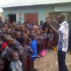 Alex speaking to Excellent Academy Pupils in Abuja, Nigeria